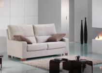 Sofá cama pequeño tapizado en blanco
